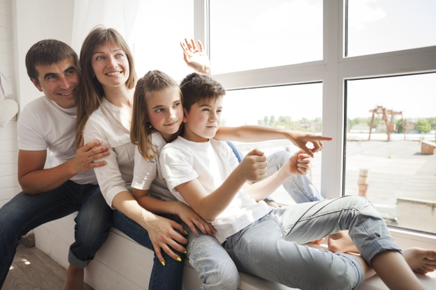 happy family after newly installed upvc windows